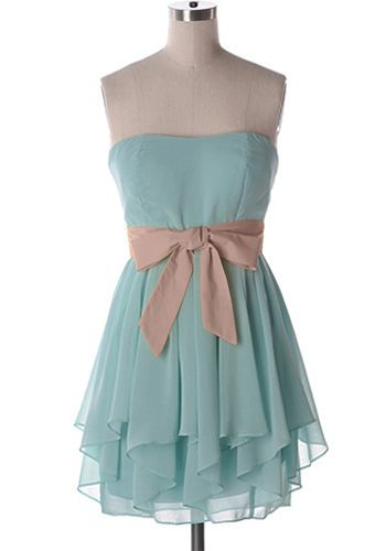 The perfect summertime party dress with layered skirt of aqua chiffon and a contrasting blush waist sash. Colour on dress form is most accurate. Side zipper. Bust pads. 100% polyester Not stretchy Lined Fits slightly small at bust. Indie, Retro, Party, Vintage, Plus Size, Convertible, Cocktail Dresses in Canada Day Dream Believer Dress in Aqua/Blush -