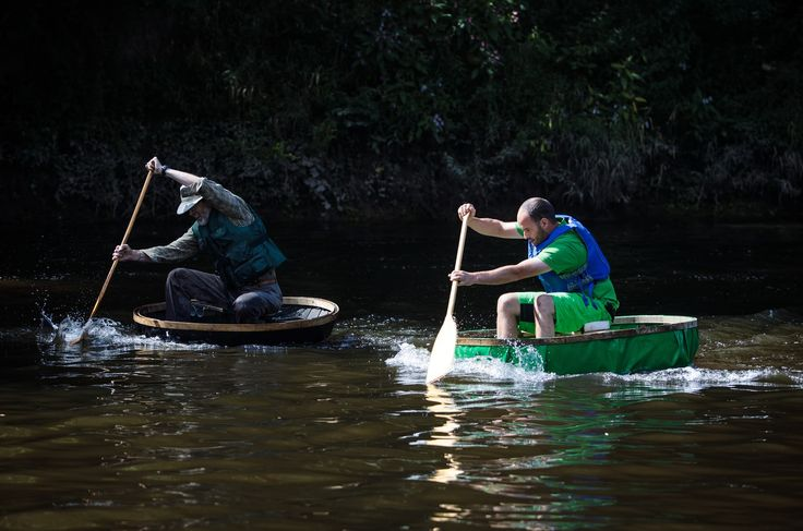 The 30th annual Ironbridge coracle regatta is held at the Ironbridge rowing club with dozens of people taking to the small boats made from an interwoven wooden frame for races and events on the river Severn in Shropshire