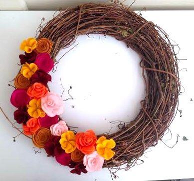 Felt flowers on grape vine wreath