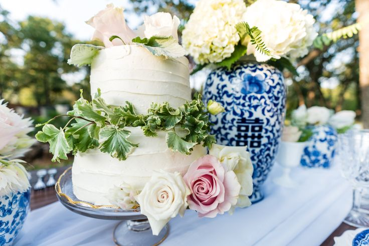 Elegant, white cake for a navy blue wedding by Cake Creations by Kim.  Such a stunning layout!  Photo taken by Ashley R West Photography.  Venue:  THE SPRINGS Event Venue in Norman.  Simple, white, two-tier, round wedding cake, wedding cake for a navy blue wedding, Oklahoma wedding cake baker, Oklahoma City wedding cake baker