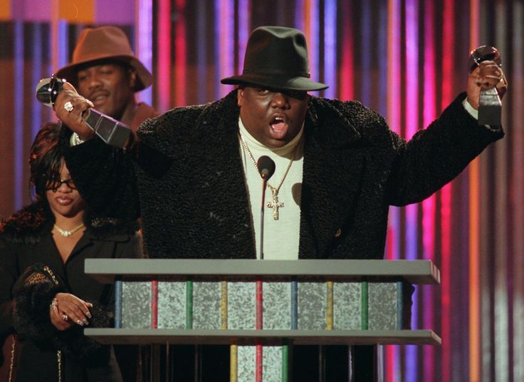 Biggie Smalls Is Still B.I.G. 20 Years After His Death  In this Dec. 6 1995 file photo The Notorious B.I.G. who won rap artist and rap single of the year clutches his awards at the podium during the annual Billboard Music Awards in New York. A top rapper was shot to death on the eve of the release of his long-awaited sophomore album  the eerily titled Life After Death. Biggie was just 24 when he died.