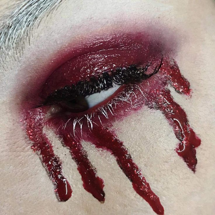 Halloween makeup using Kat Von D beauty liquid lipsticks in Vampira and Outlaw. NYX cosmetics red velvet butter gloss for lid shine.