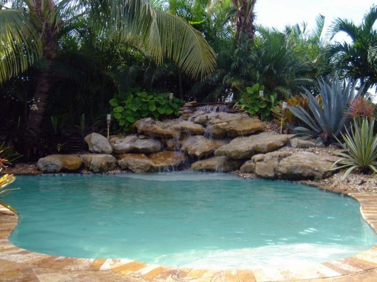 Swimming Pool Minimalist Round Pool With Waterfall Appliances Also Decorative Plants Design