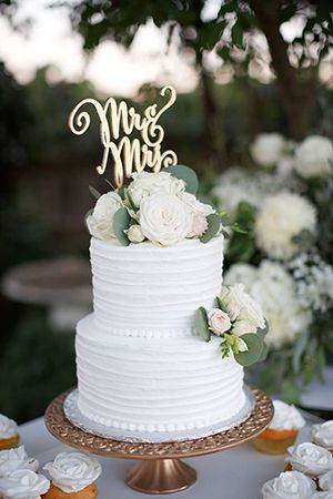 2017 trending greenery floral wedding cake with monogram topper