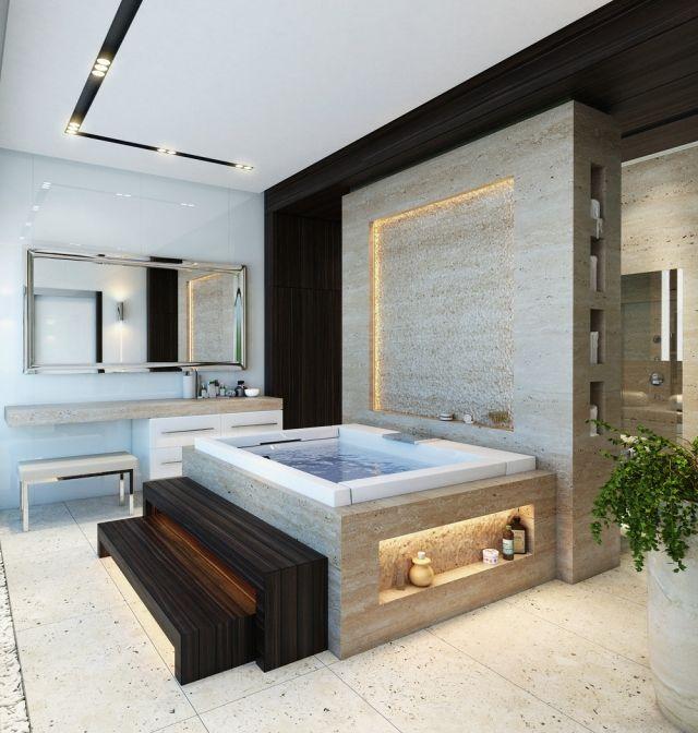 une baignoire carrée avec un éclairage encastré et un escalier en bois