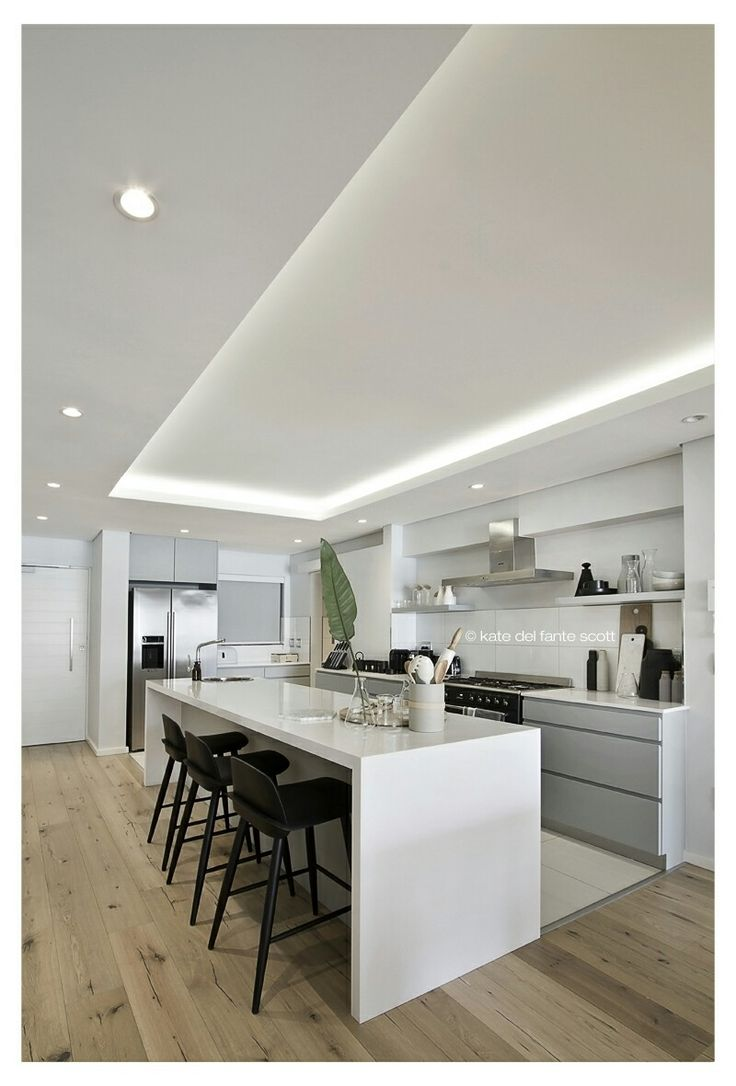FourOnC Cape Town. Interiors by Del Fante Design Grey and white contemporary kitchen with black Hay barstools