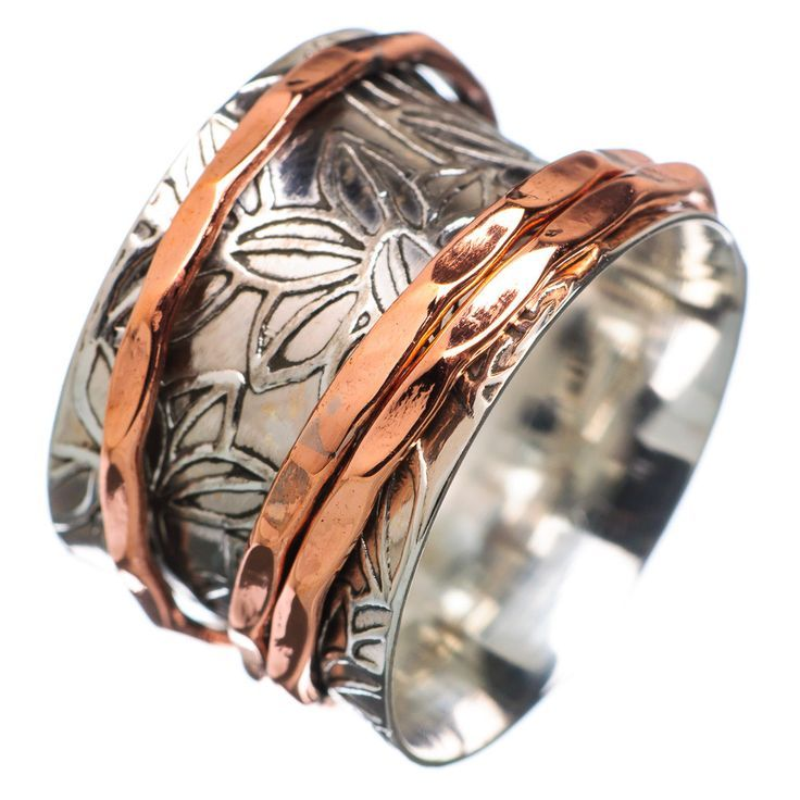 """Solid Sterling Silver and Copper Spinner Ring DETAILS: * Size 7 * 5.4 g total weight * SOLID .925 Sterling Silver * Stamped .925 * Measures approximately 1/2"""" wide Spinner Rings are also called Tibeta"""