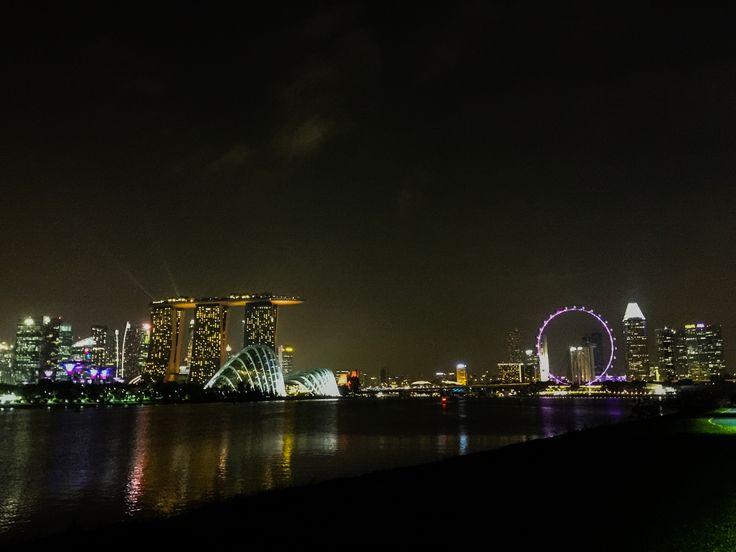 Night view along riverbank overlooking Marina Bay Sand