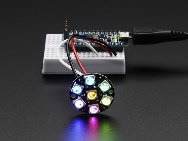 NeoPixel Jewel - 7 x WS2812 5050 RGB LED with Integrated Drivers: Be the belle of the ball with the NeoPixel Jewel!  We fit seven of our tiny 5050 (5mm x 5mm) smart RGB LEDs onto a beautiful, round PCB with mounting holes and a chainable design to create what we think is our most elegant (and evening-wear appropriate) NeoPixel board yet.