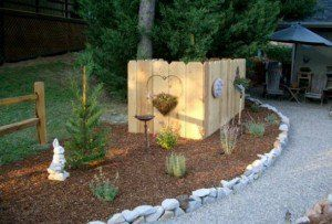 How to hide a propane tank build a cute fence around it gardening ideas pinterest - Garden ideas to hide fence ...