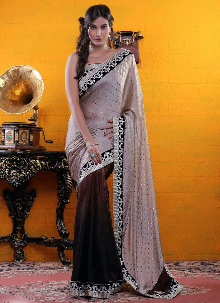 http://www.sareebuzz.in/sarees/staggering-brown-and-beige-lace-work-party-wear-designer-saree-9382  Staggering Brown And Beige Lace Work Party Wear Designer Saree  Item Code: : 9382  Color : Brown Beige  Occasion : Ceremonial Reception  Fabric : Satin  Work : Embroidered Resham  For Inquiry Or Any Query Related To Product, Contact :- +91 9974 111 22