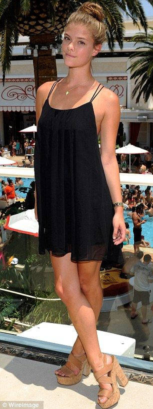 Nina Agdal displayed her toned limbs in a form fitting black dress at the Encore Beach Club at Encore Las Vegas.