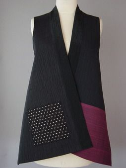 Long Kimono Vest with Deep Magenta Pocket | Intense stitching and color blocking . The stitched lines are a subtle gray on black. With a Japanese printed ikat patterned pocket.