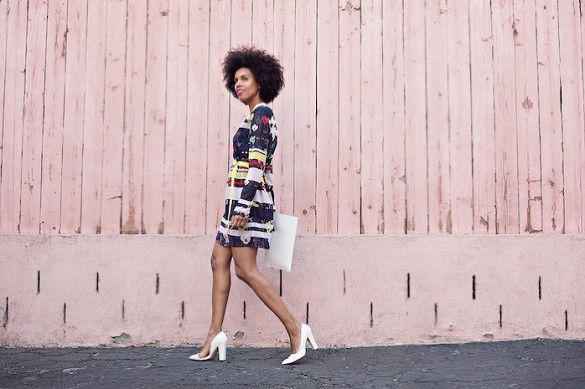 Grasie Mercedes wears a printed long-sleeve mini dress with white pumps