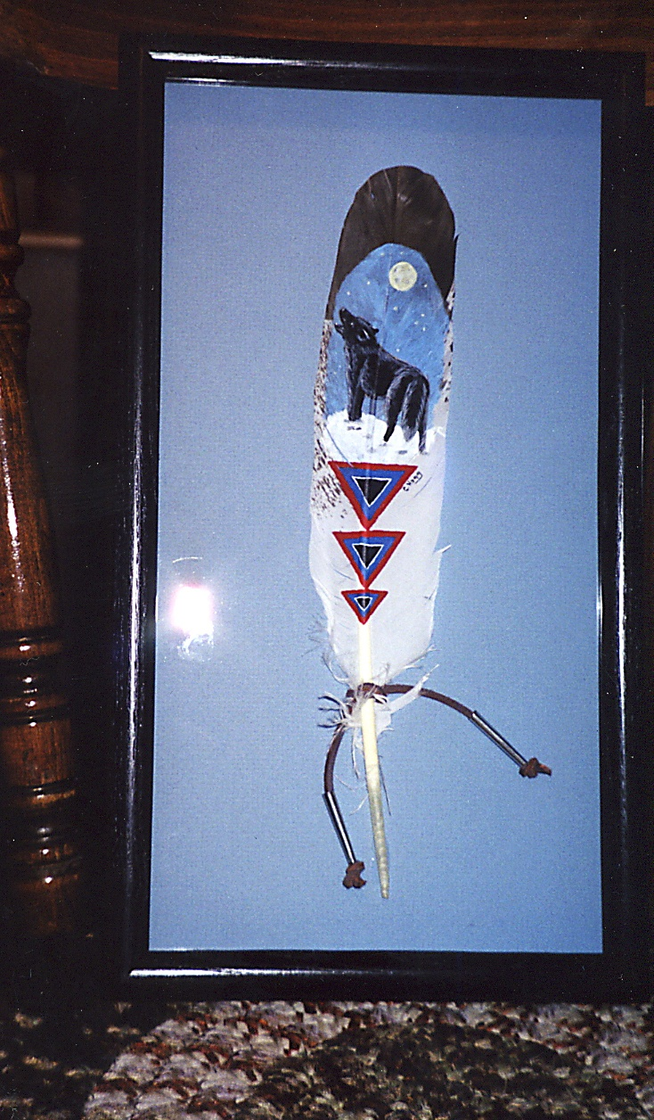 Wolf and full moon in snow Native American theme on imitation Eagle feather. http://greaseandgrace.com/