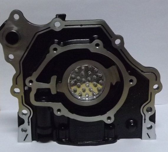 Led Lamp built out of a recycled car oil pump.