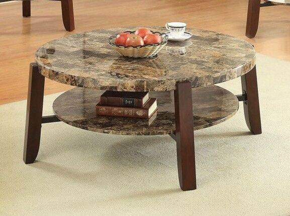"""Lilith collection faux marble top and cherry finish wood round coffee table.  Coffee table measures 40"""" x 40"""" x 18"""" H.  Some assembly required."""