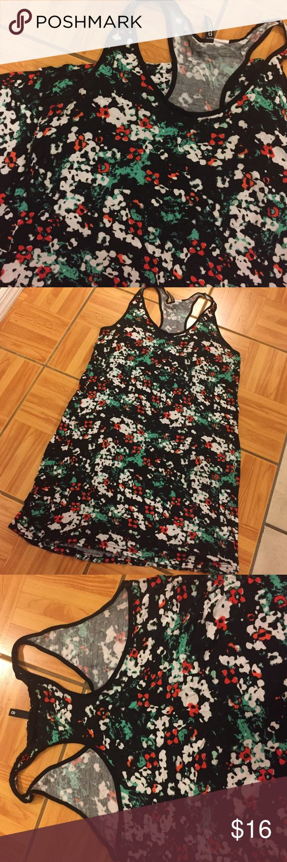 Multi Color Awesome Print Women's Tunic Tank Top Brand Divided purchased from H&M. •Overall Color: Black •Print Color: Red/ White/ Green •GENTLY worn •100% Rayon •Racer Back Style  👾NO TRADES 👾OFFERS WELCOMED! 👾BUNDLE TO SAVE  👾FEEL FREE TO ASK ANY QUESTIONS Divided Tops Tunics