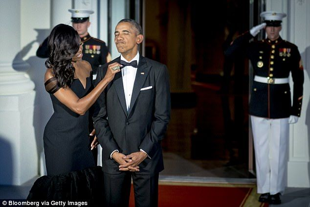 Obama also shared the story behind the viral photo (above) of her adjusting his bow tie just before the September 2015 state dinner. She said she was 'bored' while waiting for cars to roll in and 'thought, let me make sure my husband looks good'