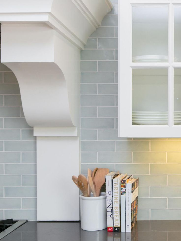 Subway tiles in a pale blue-gray give depth to the backsplash and make the white cabinetry feel even more fresh.