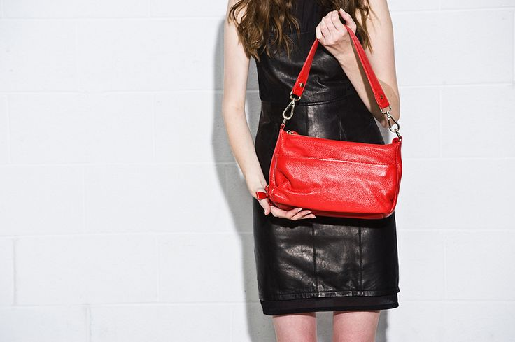 Red and black - classic and dramatic combo. Red leather Kelly Brown bag and black leather dress