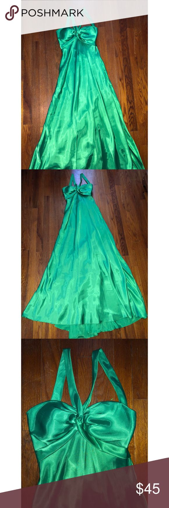 Emerald green formal dress Emerald green floor length formal dress. Fun criss cross straps in back. Worn once-excellent condition. Size is 5/6 but fits like 2/4. Minimal train in back. Dresses Prom