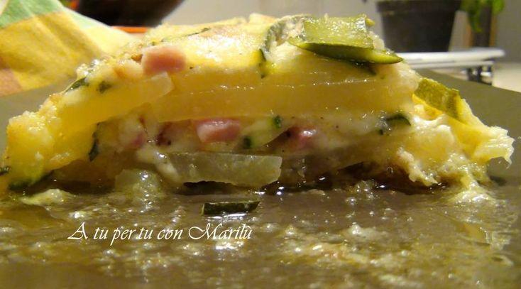 Ingredienti e procedimento: 2 zucchine medie, 2patate, olio, sale e pepe, cubi di scamorza o mozzarella, cubetti di cotto, parmigiano e pangrattato