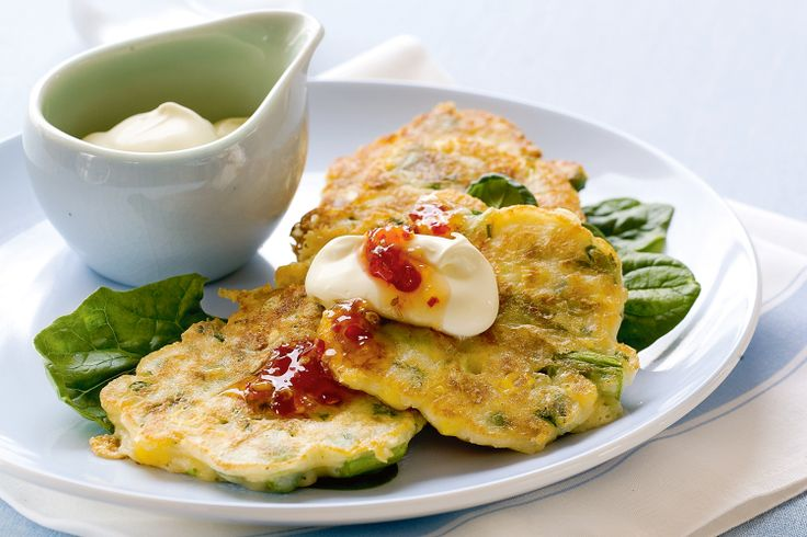 Golden corn fritters are given a flavour boost with asparagus, chives and cheese.