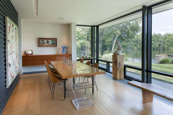 Clean lines and those breathtaking lake views are all the adornment this midcentury dining room needs.
