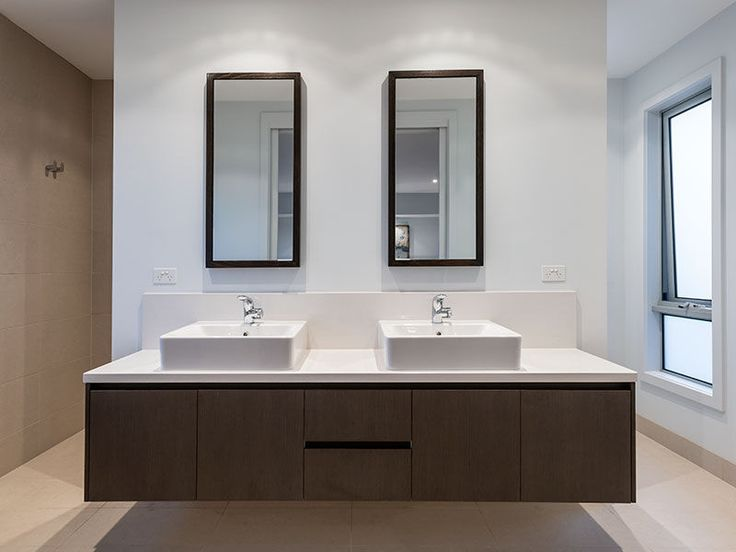 vanity with walk behind shower and toilet