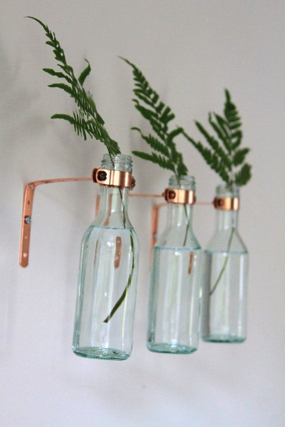 Copper wine bottle sconce, vase or candle holder.  Easily mounts to wall using simple nail or screw. No additional hardware necessary. These