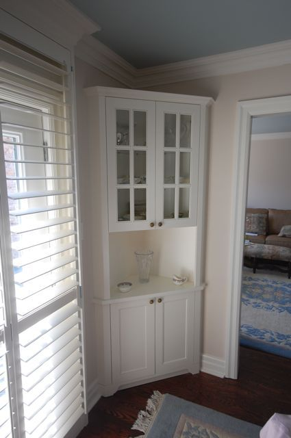 Dining room corner cabinet designed and built for clients.     - CLICK TO ENLARGE