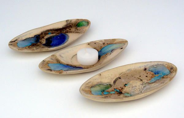 This piece is a oval shaped dish and is decorated with swirls of oxides, glass and glaze to represent an aerial view of the rugged Irish landscape. http://www.marketdirect.ie/small-oval-nightlight