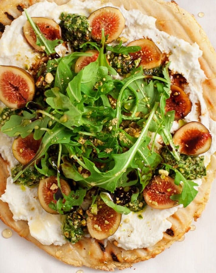Fig and ricotta flatbread pizza. Get the recipe for this delightful combo.