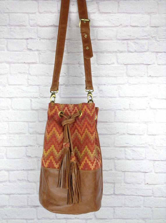 brown leather bucket bag with leather tassels and chevron woven fabric by WOLF BLOSSOM