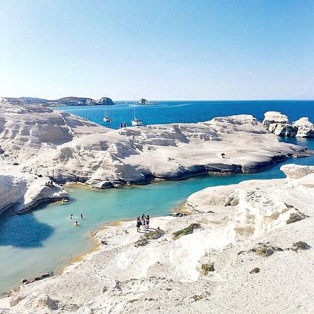 An extremely unique moonscape in Sarakiniko beach , at Milos island (Μήλος) . Gigantic white volcanic rocks creating small and big caves in combination with the small beach makes it a perfect lunar landscape on earth .