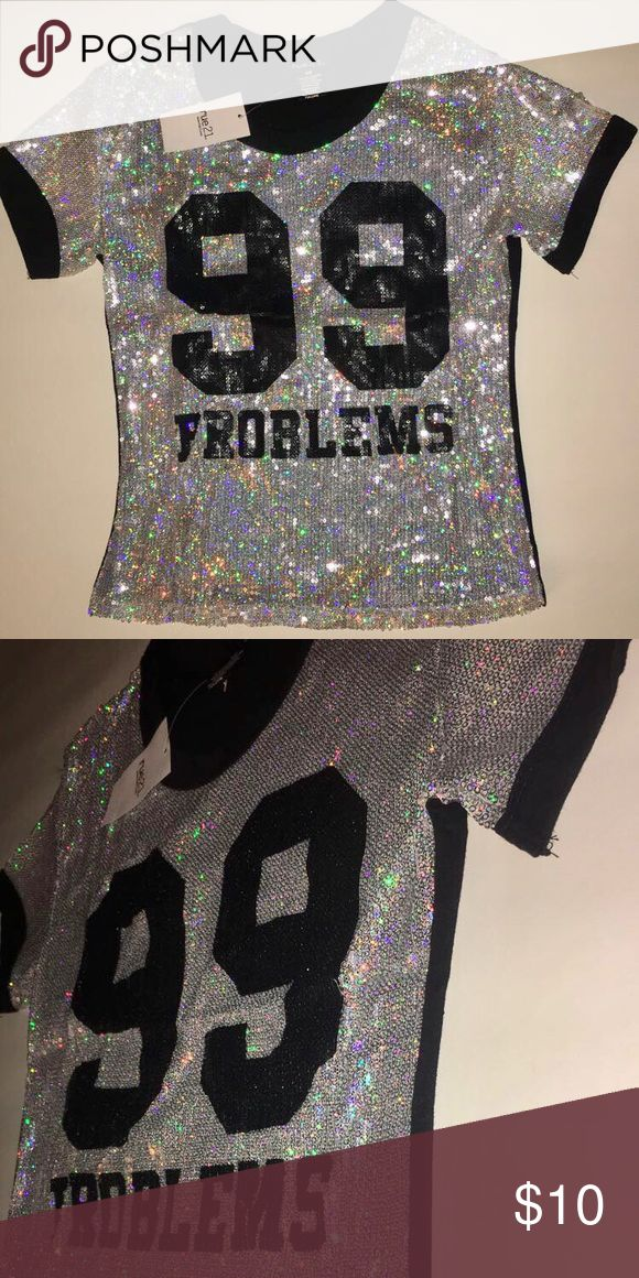 Sequined 99 Problems Top Beautiful sparkly sequined topped with 99 Problems written on the front in black sequins. The back on the top is a solid black. Brand new with tag and never been worn😊✨ Rue 21 Tops Tees - Short Sleeve