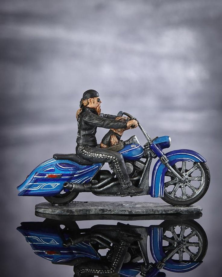 Collectible figurine biker with a dog metal figure