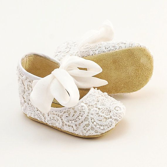 Handmade lace-covered leather baby shoes. Fully lined in leather, soft leather soles, covered with white lace, embellished with white pearls and silk