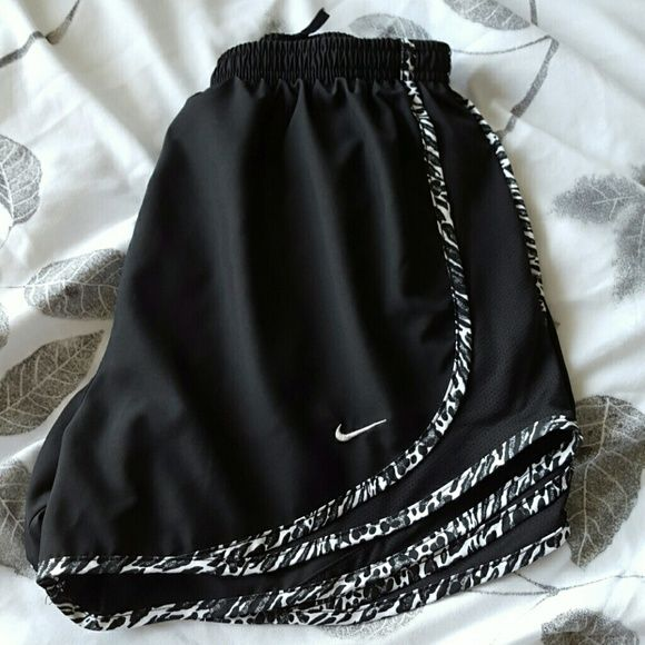 Nike tempo running shorts All black with cheetah print lining. Built in underwear. Like new condition! Hardly worn. Nike Shorts