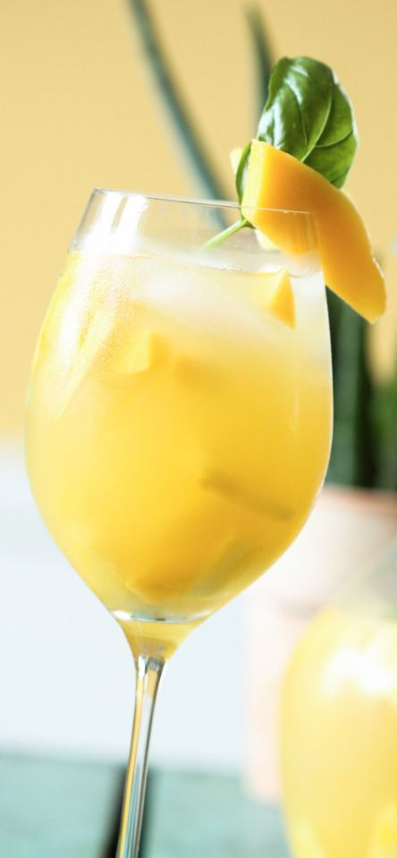 Pineapple, Mango, and Basil Sangria - a bright and tropical twist on a classic…