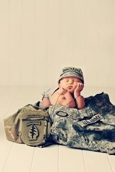 Military Newborn Photography....maybe something similar with my husband's police uniform?