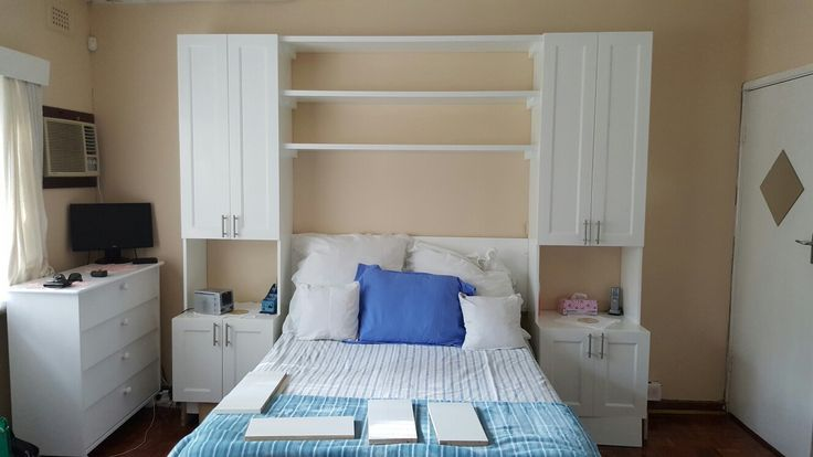 Headboard and bedside cabinets with extra overhead storage.