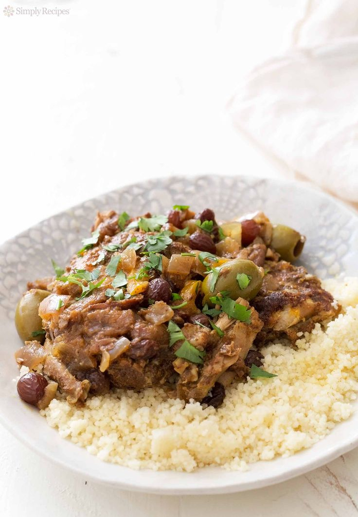 Slow Cooker Moroccan Chicken ~ Don't have a tagine? Make Moroccan chicken in a slow cooker, it's easy! Chicken thighs, plenty of spices, onions, green olives, lemons, raisins, cooked low and slow until fall apart tender. ~ SimplyRecipes.com