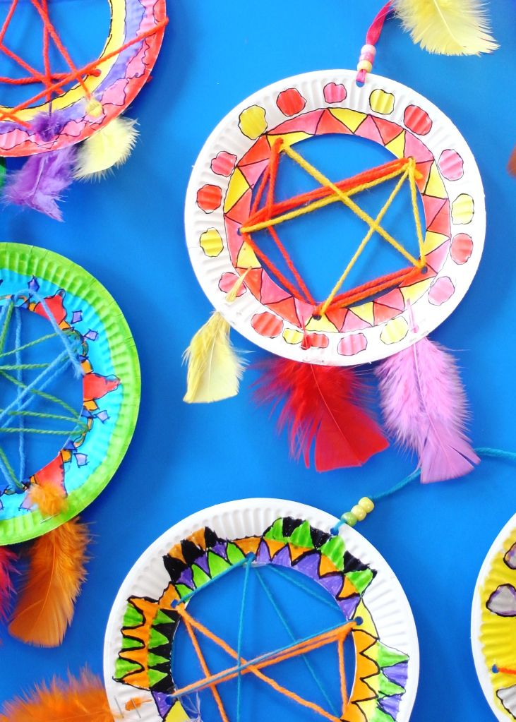 DREAM CATCHERS These Native American dream catchers are really popular with kids. Buysmall paper plates and cut out the middles with a craft knife. Then use a hole punch to create holes around t…