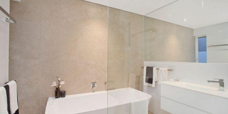 Beautifully appointed designer bathroom, walk in shower, luxurious stone bath