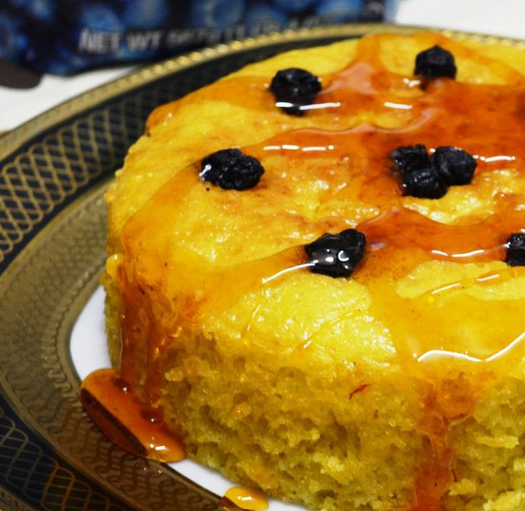 Saffron Lemon Blueberry Cake with Lemon Caramel Sauce  Enjoy the evening with a bite of this soft n stimulating cake #saffron #lemon #blueberry #cake #eggfree #amazing #caramelsauce #lemoncaramel #lipsmacking Recipe at: www.annapurnaz.in