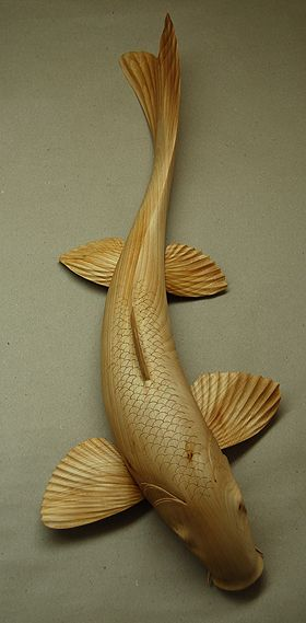 Koi Carp. I really like the action in this fish carving.                                                                                                                                                                                 Más