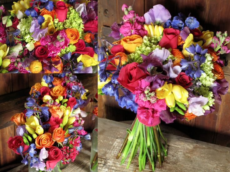 The overall style we were going for was colorful and vibrant with some vintage inspired details…more of a retro-like vintage than classic-vintage.  The bouquets were filled with fun jewel tones including dark blue delphinium, purple and lavender sweet peas, yellow freesia, orange ranunculus, raspberry pink roses, stock, mini-green hydrangea and sweet William.  The attendants wore pewter dresses so the colorful blooms were the perfect contrast.