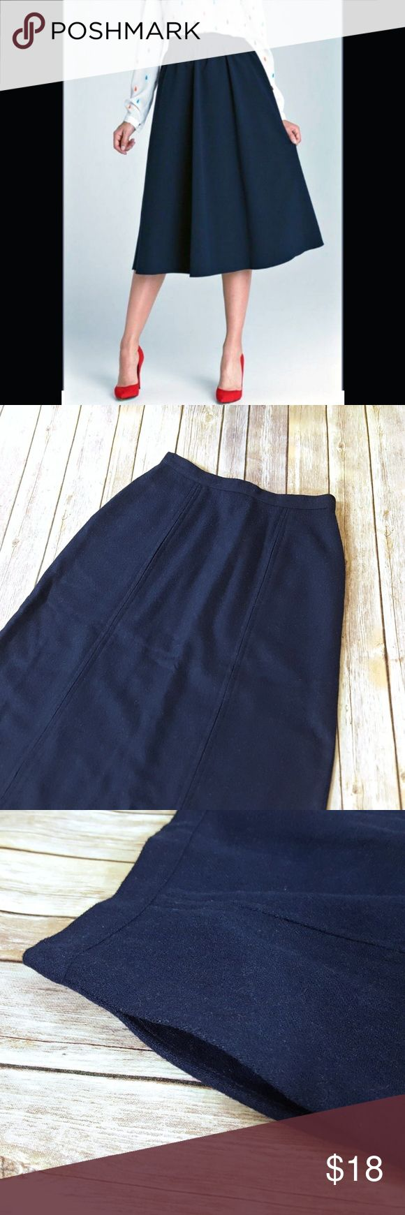 """Sapphire Blue Wool A-line Skirt Vintage Wool Midi A-line Skirt. Unlined, hidden slant fside pockets, hidden back zipper and button closure. Dartimg detail at back and tailored front pleating at front. Excellent used condition. Tag says size 8 but fits a size 0 - 2. Measures lying flat 13.5"""" waist, approx 19.5"""" hips, 24"""" at bottom hem, 28"""" total length. No designer label. Wool / or wool blend. Color is a sapphire blue. Vintage Skirts A-Line or Full"""
